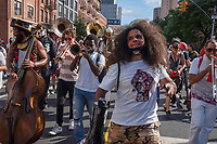 New York, NY, USA- June 19: Marching band leads a joyous celebration of Juneteenth, which commemorates the end of slavery of the United States on June 19th, 2020., In the context of widespread protests against the killing of George Floyd and other African-Americans at the hands of police, people gathered in NYC to celebrate Juneteenth which remembers the day in 1865 when Union soldiers freed enslaved people in Texas who remained in bondage three years after President Abraham Lincoln's Emancipation Proclamation decreed the end of slavery in the southern states. (Photo by Stephen Ferry/VIEWPress)