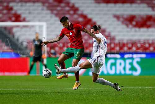 14th November 2020, The Estádio da Luz, Lisbon, Portugal; Nations League International football, Portugal versus France; João Cancelo of Portugal is tackled by Adrien Rabiot of France