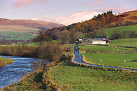 View of River Hodder looking towards Burholme from Burholme Bridge with farm and farm track..