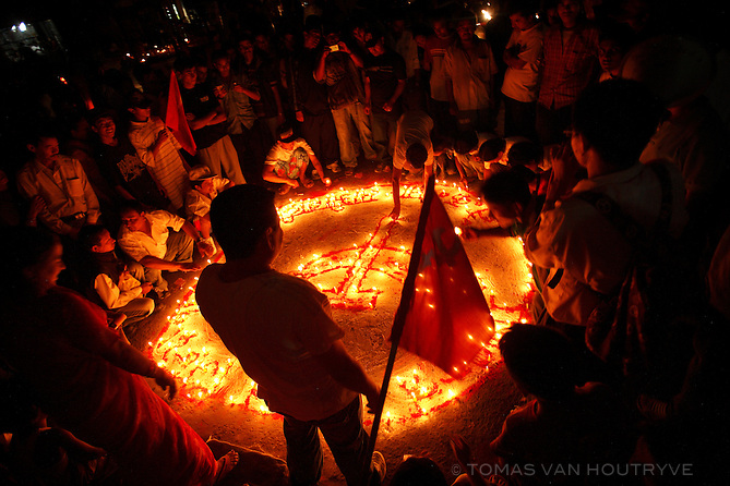 Maoists celebrate the abolition of the monarchy and the declaration of Nepal as a federal republic by lighting candles in the shape of a hammer and sickle in Kathmandu on 29 May, 2008. The Maoists started their revolution against the Shah dynasty in 1996 and fought for a decade to topple the monarchy by force. In 2006 they reached an agreement with other political parties to remove the monarchy through a combination of street protests and eventually elections.