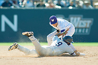 Cal State Fullerton Titans Hank LoForte (9) is tagged out after he slides into second base during the game against the University of Washington Huskies at Goodwin Field on June 09, 2018 in Fullerton, California. The Cal State Fullerton Titans defeated the University of Washington Huskies 5-2. (Donn Parris/Four Seam Images)