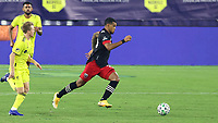 NASHVILLE, TN - SEPTEMBER 23: Gelmin Rivas #20 of DC United is chased by Dax McCarty #6 of Nashville SC during a game between D.C. United and Nashville SC at Nissan Stadium on September 23, 2020 in Nashville, Tennessee.