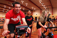 Chris Sinclair, BIKENZ trainer (left), races Tamara Bedford on the wattbikes at the Move 60 event run by Cocacola at Pioneer Stadium Gymnasium, Christchurch, New Zealand on Saturday, 12 April 2014. Photo: Joseph Johnson.