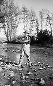 0705-J06 man fishing. Montana. 1930s