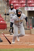 Burlington Bees right fielder Francisco Del Valle (18) swings at a pitch against the Cedar Rapids Kernels at Veterans Memorial Stadium on April 14, 2019 in Cedar Rapids, Iowa.  The Bees won 6-2.  (Dennis Hubbard/Four Seam Images)