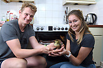 Pictured:  Will Hall and Alice Kendall with the duckling in front of their oven which it hatched in.<br /> <br /> A couple have become the unexpected owners of a duckling after finding an abandoned egg - and hatching it in their oven.  Heartwarming photographs and videos show the days-old duckling following Will Hall and Alice Kendall around their home after they rescued it, even 'terrifying' their big German pointer, Meg.<br /> <br /> Mr Hall, a teacher at leading independent school Winchester College, discovered the duck egg while out walking in a grassy area on Saturday and couldn't find its nest.  Not wanting to leave the egg, the 26 year old FaceTimed his events coordinator partner and the pair hatched a plan to save it.<br /> <br /> Miss Kendall, 22, preheated the oven at their home in Winchester, Hants, ready for their arrival, setting up a makeshift incubator by placing a tea towel on a baking tray.  SEE OUR COPY FOR DETAILS.<br /> <br /> © Simon Czapp/Solent News & Photo Agency<br /> UK +44 (0) 2380 458800