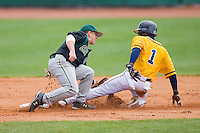 Shortstop Justin Roland #16 of the Charlotte 49ers tags out George Hines #1 of the North Carolina A&T Aggies as he tries to steal second base at War Memorial Stadium March 23, 2010, in Greensboro, North Carolina.  Photo by Brian Westerholt / Four Seam Images