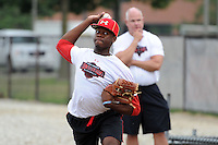 Under Armour All-American selection Touki Toussaint of Coral Springs Christian High School in Coral Springs, Florida throws a bullpen session under the watch of former major league pitcher Jim Morris at the University of Illinois at Chicago on August 22, 2013 in Chicago, Illinois in preparation for the Under Armour All-American Game that will take place at Wrigley Field on August 24th.  (Mike Janes/Four Seam Images)