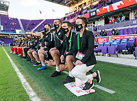 ORLANDO, FL - FEBRUARY 21: Bev Priestman of Canada kneels during their national anthem before a game between Canada and Argentina at Exploria Stadium on February 21, 2021 in Orlando, Florida.