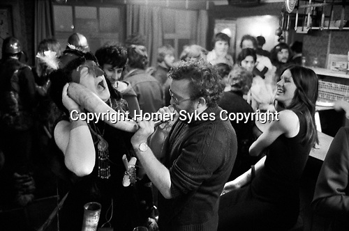 Isle of Man, Peel 1970s. The annual Viking Festival annually in July. Viking in a local pub after the main event on the beach, getting a little drunk and having fun. 1978.