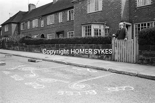 """Royal May Day Knutsford, Cheshire, England. 1973. Sand Painting out side the home of May Queen's grandfather. It reads """"God Bless Our Royal May Queen.""""Eliane Murray 1973 May Queen."""