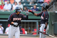 Center fielder Jacob May (20) of the Kannapolis Intimidators, left, is congratulated by Tim Anderson after hitting a leadoff home run in a game against the Greenville Drive on Monday, August 5, 2013, at Fluor Field at the West End in Greenville, South Carolina. May was a third-round pick by the Chicago White Sox in the 2013 First-Year Player Draft. Kannapolis won, 3-0. (Tom Priddy/Four Seam Images)