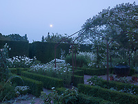The much-copied 'white garden' at Sissinghurst Castle photographed in the moonlight