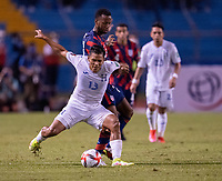 SAN PEDRO SULA, HONDURAS - SEPTEMBER 8: Andy Najar #17 of Honduras is defended by Kellyn Acosta #23 of the United States during a game between Honduras and USMNT at Estadio Olímpico Metropolitano on September 8, 2021 in San Pedro Sula, Honduras.