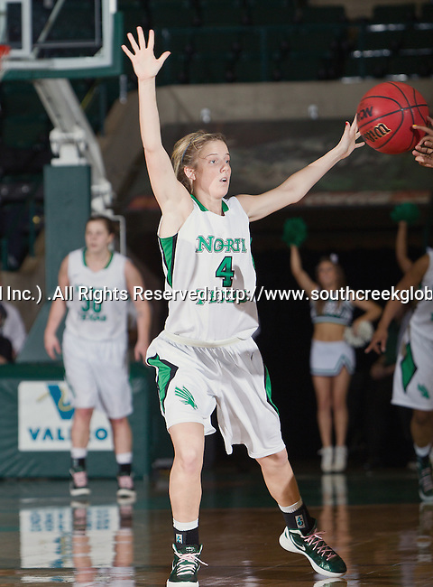 North Texas Mean Green guard Laura McCoy (4) in action during the game between the Louisiana Lafayette Ragin' Cajuns and the University of North Texas Mean Green at the North Texas Coliseum,the Super Pit, in Denton, Texas. UNT defeats Louisiana Lafayette 78 to 40....