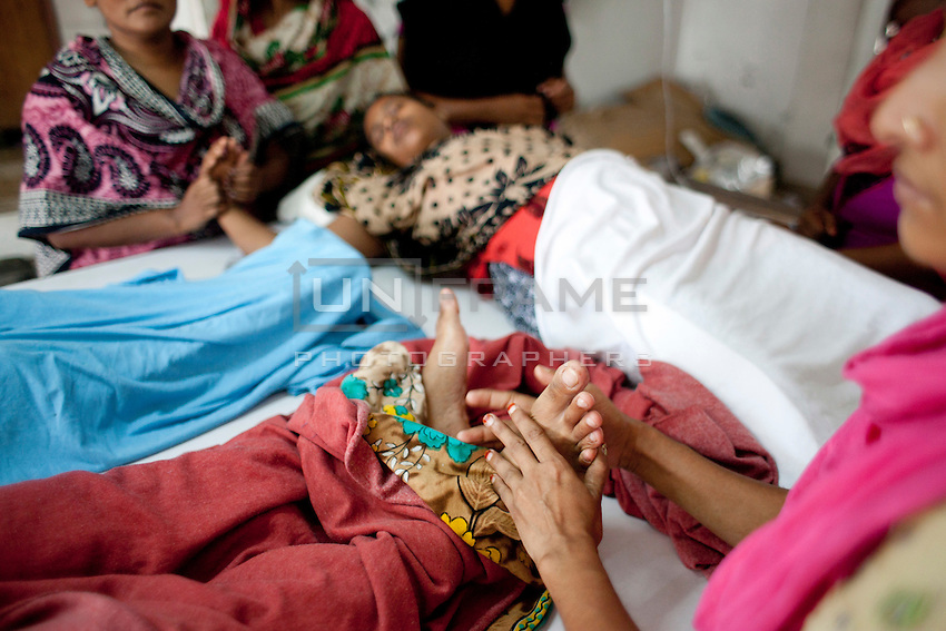 Bangladeshi garments Workers lay weary on Tuba Group's garments factory on the fifth day of their hunger strike demanding the outstanding three months salary and Eid bonuses. Dhaka, Bangladesh