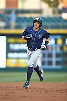 Mikie Mahtook (9) of the Toledo Mud Hens rounds the bases after hitting a home run against the Charlotte Knights at BB&T BallPark on April 24, 2019 in Charlotte, North Carolina. The Knights defeated the Mud Hens 9-6. (Brian Westerholt/Four Seam Images)