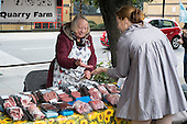 Customers buy food at a farmers' market in West Hampstead, London.