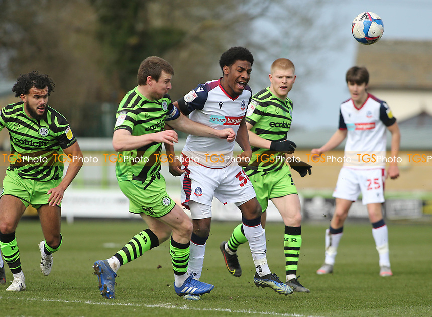 Forest Green Rovers's Chris Stokes and Bolton Wanderers's Oladapo Afolayan during Forest Green Rovers vs Bolton Wanderers, Sky Bet EFL League 2 Football at The New Lawn on 27th March 2021