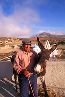 Old Man with Donkey in the Old Traditional Village,  Santorini, Greece