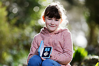 Pictured: Elly Neville with The British Citizen Award for the Good of the Country at her home in Pembroke, west Wales, UK. Tuesday 20 February 2018<br /> Re: Seven-year-old Elly Neville who was born despite doctors saying her parents would not be able to have any more children, has raised over £150,000 for the cancer ward that treated her father.<br /> Her parents Lyn and Ann had been told they were unlikely to have more children after he underwent a bone marrow transplant in 2005. <br /> Mr Neville subsequently spent a lot of time on the Ward 10 cancer facility at Withybush Hospital in Haverfordwest, Pembrokeshire.<br /> But four years later they were stunned when his painter and decorator wife Ann fell pregnant again.