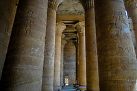 Pillars inside the Court of Offerings at Edfu temple of Horus which is known for the major Ptolemaic temple built from sandstone blocks between 237 BCE and 57 BCE into the reign of Cleopatra VII. Edfu temple is the second largest one in Egypt after Karnak temple, south of Egypt.