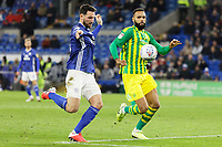 (L-R) Sean Morrison of Cardiff City takes a shot past Kyle Bartley West Bromwich Albion which provided the assist for Callum Paterson of Cardiff City (not pictured) to score the opening goal during the Sky Bet Championship match between Cardiff City and West Bromwich Albion at the Cardiff City Stadium, Cardiff, Wales, UK. Tuesday 28 January 2020
