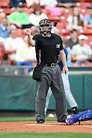 Home plate umpire Jonathan Bailey makes a call during a Buffalo Bisons game Gwinnett Braves on May 13, 2014 at Coca-Cola Field in Buffalo, New  York.  Gwinnett defeated Buffalo 3-2.  (Mike Janes/Four Seam Images)