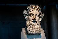Head sculpture exhibited in the Hall of the Machines. Centrale Montemartini. Rome, Italy. Mar. 07, 2015