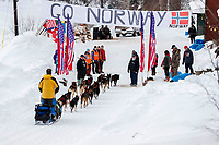 Andy Pohl is greeted by volunteers in the afternoon at the Takotna checkpoint during the 2018 Iditarod race on Wednesday March 07, 2018. <br /> <br /> Photo by Jeff Schultz/SchultzPhoto.com  (C) 2018  ALL RIGHTS RESERVED