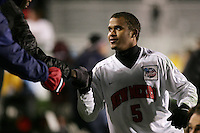 New Mexico's Blake Danaher celebrates the win with fans after the game. The University of New Mexico Lobos defeated the Clemson University Tigers 2-1 in a Men's College Cup Semifinal at SAS Stadium in Cary, NC, Friday, December 9, 2005.