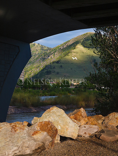 mount sentinel and the M from under the orange street bridge in missoula, montana along the clark fork river