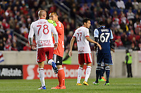 Harrison, NJ - Wednesday Feb. 22, 2017: Aurelien Collin, Luis Robles during a Scotiabank CONCACAF Champions League quarterfinal match between the New York Red Bulls and the Vancouver Whitecaps FC at Red Bull Arena.