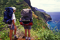 Backpackers on the dramatic Kalalau trial, Na Pali coast, Island of Kauai.