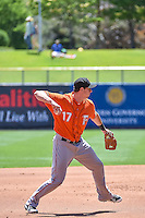 Matt Duffy (17) of the Fresno Grizzlies throws to first base on defense against the Salt Lake Bees in Pacific Coast League action at Smith's Ballpark on June 14, 2015 in Salt Lake City, Utah.  (Stephen Smith/Four Seam Images)