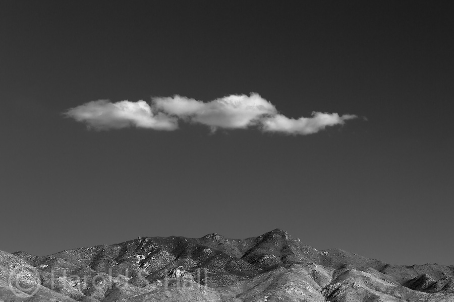 Driving the long stretches of highway in Nevada, lone clouds make for interesting compositions.