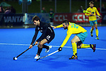 Australia's Trent Mitton (right) pressures NZ's Dominic Newman during the Sentinel Homes Trans Tasman Series hockey match between the New Zealand Black Sticks Men and the Australian Kookaburras at Massey University Hockey Turf in Palmerston North, New Zealand on Tuesday, 1 June 2021. Photo: Dave Lintott / lintottphoto.co.nz