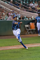 Ogden Raptors third baseman Kenneth Betancourt (9) throws to first base during a Pioneer League game against the Billings Mustangs at Lindquist Field on August 17, 2018 in Ogden, Utah. The Billings Mustangs defeated the Ogden Raptors by a score of 6-3. (Zachary Lucy/Four Seam Images)