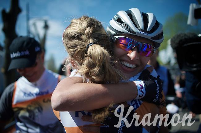 a teammate congratulates Anna van der Breggen (NLD/Rabobank-Liv) after winning the 2015 Flèche Wallonne Féminine