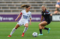 BRIDGEVIEW, IL - JULY 18: Lauren Barnes #3 of the OL Reign dribbles the ball during a game between OL Reign and Chicago Red Stars at SeatGeek Stadium on July 18, 2021 in Bridgeview, Illinois.