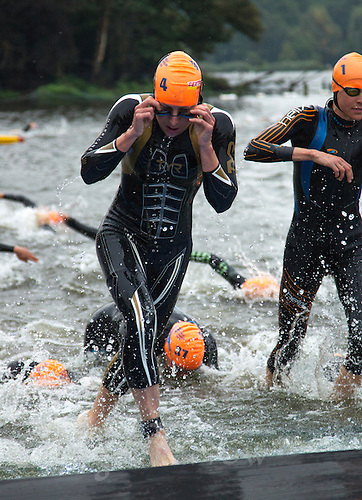 14 SEP 2013 - LONDON, GBR - Jodie Stimpson (GBR)  of Great Britain leaves the water at the end of the first swim lap during the elite women's ITU 2013 World Triathlon Series Grand Final in Hyde Park, London, Great Britain (PHOTO COPYRIGHT © 2013 NIGEL FARROW, ALL RIGHTS RESERVED)