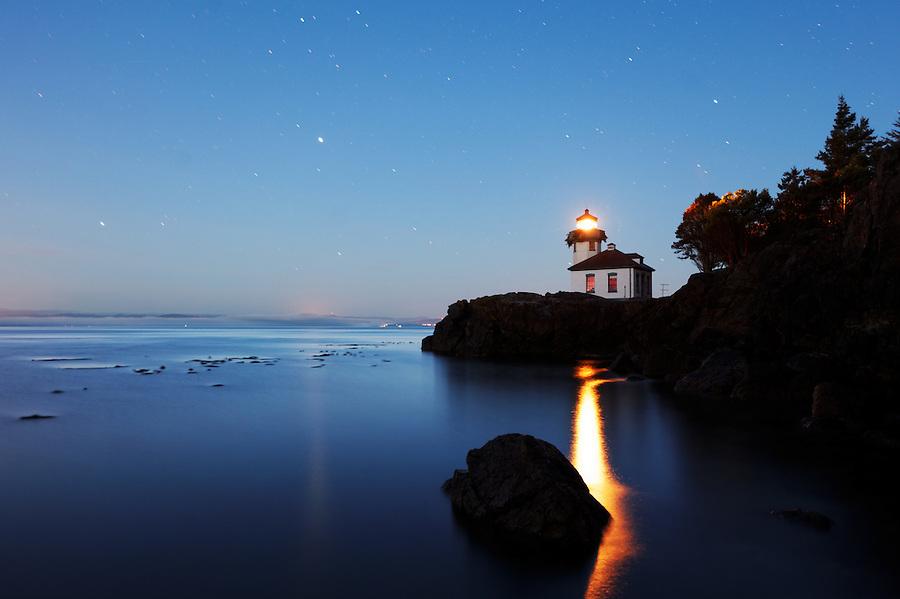 Lime Kiln Lighthouse stands watch over Haro Strait under a starry sky, Washington