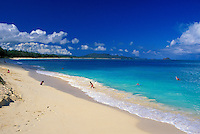 Waimanalo Beach's white sands and warm blue waters are inviting to all.  Windaward Oahu.