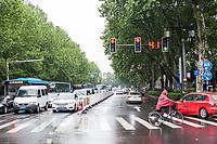 Nanjing, Jiangsu, China.  Street Traffic on a Rainy Day.