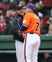 Head coach Chad Holbrook of the South Carolina Gamecocks, left, meets head coach Jack Leggett of the Clemson Tigers on Saturday, March 2, 2013, at Fluor Field at the West End in Greenville, South Carolina. Clemson won the Reedy River Rivalry game 6-3. (Tom Priddy/Four Seam Images)
