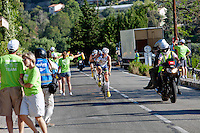 Triathlete Frederik Van Lierde passes a refreshment station at the head of the pack at Ironman France 2012, Nice, France, 24 June 2012. Frederik went on to win first place.