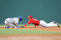 Second baseman Wendell Rijo (11) of the Greenville Drive stretches but is unable to put out Luis Villegas (15) of the Lexington Legends at second base in a game on Sunday, August 31, 2014, at Fluor Field at the West End in Greenville, South Carolina. Rijo is the No. 18 prospect of the Boston Red Sox, according to Baseball America. Greenville won, 3-2. (Tom Priddy/Four Seam Images)