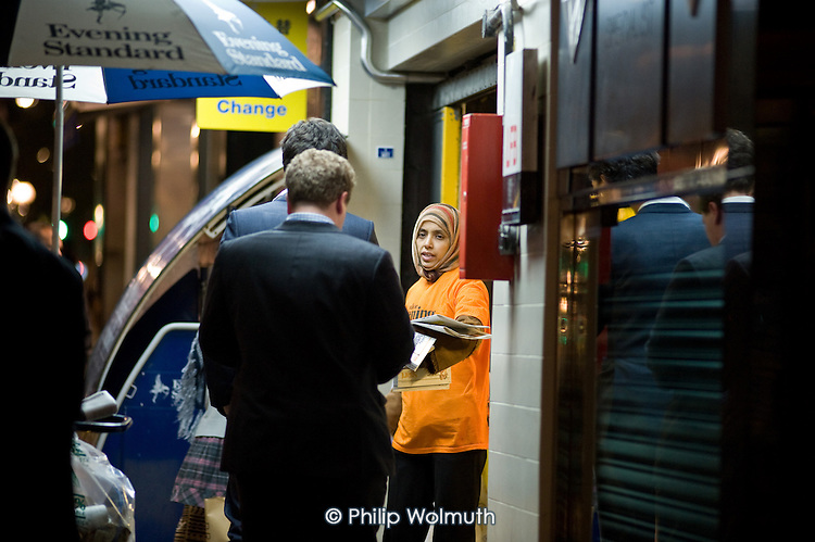 A contract worker gives away free copies of the  London Evening Standard outside Bond Street tube station.  The newspaper, owned by Russian oligarch Alexander Lebedev, became a freesheet and replaced its 300 strong network of self-employed street vendors with salaried staff working for a contractor in 2009.