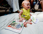 Lila Reynolds, 8 months, get to experience Saratoga Race Course on Travers Stakes Day  in Saratoga Springs, New York on August 25, 2012.