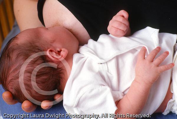 newborn baby boy 1 week old closeup fed nursing at breast horizontal caucasian